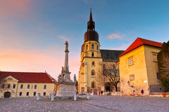 Trnava, Slovakia. Monument and a church of saint Nicolaus in centre of Trnava, Slovakia Royalty Free Stock Images