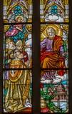 Trnava - Stet Joseph och biskopen på fönsterrutaform 19 cent i den St Nicholas kyrkan Royaltyfri Fotografi