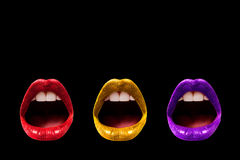 Trío de los labios aislados en negro Imagen de archivo libre de regalías
