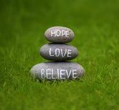 Tro, hoppas och älska Arkivbilder