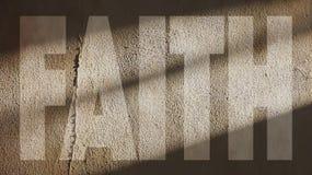 Tro som är skriftlig på en vägg Royaltyfri Fotografi