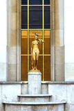 Trocadero - Gold woman statue - Paris. The Trocadéro, site of the Palais de Chaillot, is an area of Paris, France, in the 16th arrondissement, across the royalty free stock image