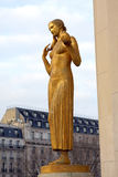 Trocadero - Gold woman statue - Paris. The Trocadéro, site of the Palais de Chaillot, is an area of Paris, France, in the 16th arrondissement, across the stock image