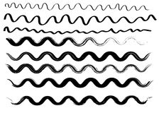 Trockene Bürste des Schmutzes streicht Wellensammlung Lokalisiert, Vektor Hand gezeichneter Satz Stockfotografie