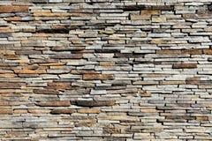Trockene bunte Steinwand Stockfoto