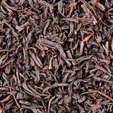 Trockene schwarze Teeblätter Stockfotografie