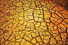 Trockener gebrochener Erdehintergrund lizenzfreie stockbilder