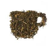 Trockener grüner Tee schaffen eine Schalenteeform Stockfotografie