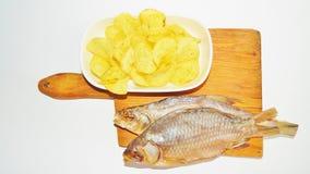 Trockenfisch, Chips Stockbilder