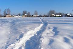 Trodden path in the snow to the village, Russia Stock Photos