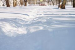 Trodden town path in snow in the morning after snowfall Royalty Free Stock Photos