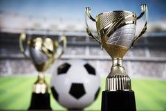 Troféu do vencedor, equipamento de esporte e bolas Fotos de Stock