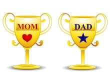 Trofei dell'oro del papà e della mamma Fotografie Stock
