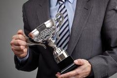 Trofeo del negocio que gana Foto de archivo libre de regalías