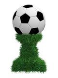 Trofeo della sfera di calcio sul basamento dell'erba verde Fotografia Stock Libera da Diritti