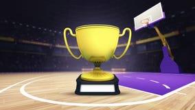 Trofeo dorato dei campioni sul campo da pallacanestro all'arena Immagine Stock