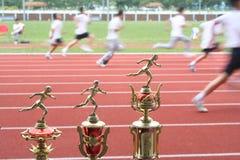 Trofeo y corredores Imágenes de archivo libres de regalías
