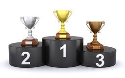 Trofeos en el podium del ganador Fotos de archivo libres de regalías