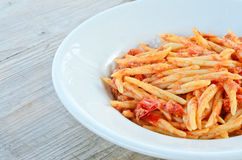 Trofie with ragù. Cooked italian pasta with tomato sauce and meat on table wood Stock Photography