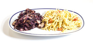 Trofie and salad. A dish with trofie (italian pasta) with salad of chicory Stock Photography