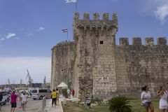 Day view of Kamerlengo Caste in Trogir in summer season. TROGIR, CROATIA - AUGUST 12 2017: Day view of Kamerlengo Caste in Trogir in summer season, with people Stock Images