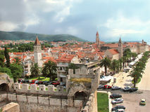 Trogir, Croatia. Trogir - famous historic town in Croatia (Dalmatia). Aerial view on ancient Trogir with green palms, hills and red roofs. Outdoors Stock Photos