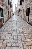 Cobbled stone alley in the old town of Trogir stock photos