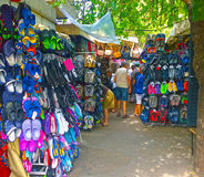 Trogir, Croatia - open air shoe market. TROGIR,CROATIA -  colorful open air market open daily in Trogir, tourists visit kiosks looking for beach shoes and Royalty Free Stock Photo