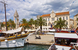 TROGIR, CROATIA sea promenade with an ancient building, palm and Royalty Free Stock Photos