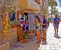 Trogir, Croatia - Tourists at souvenir shop on a warm sunny day Stock Photo