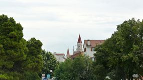 Trogir, Croatia - 07 25 2015 - View of the Bell Tower of the St. Lawrence Cathedral through the trees royalty free stock photography