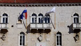 Trogir flags. Trogir in Dalmatia,  flags on the palace stock video