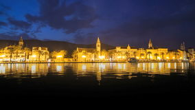 Trogir at night, Croatia. Sky is still blue, light reflections in water stock video