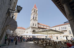 Trogir. Seaside Restaurant. TROGIR, CROATIA - MAY 19, 2013: people are taking a brake in one of the street cafe in Trogir. On May 19, 2013, in Trogir, Croatia Royalty Free Stock Images