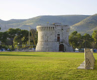 Trogir, Sr. Mark tower and green field Stock Photography