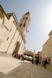 Trogir Tour. TROGIR, CROATIA - MAY 19, 2013: Pedestrians in the historic center of Dalmatian city of Trogir, Croatia On May 19, 2013, in Trogir, Croatia Stock Photo