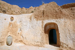Troglodyte communities. Matmata, Tunisia. The largest region of the troglodyte communities. One of many dwellings - fragment of courtyard excavated in the rock ( Royalty Free Stock Photos