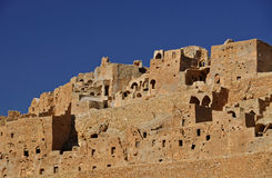 Troglodytic village in the desert Stock Photo