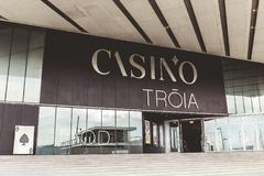 Troia Casino, a contemporary casino with gaming tables, slot machines, a stage & bar at an upscale hotel stock image