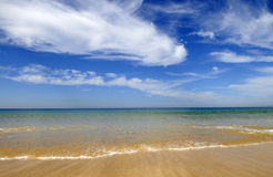 Beautiful Sky, Clear Blue Water, Beach, Summer Holidays, Sun Royalty Free Stock Images