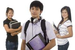 Trois étudiants asiatiques Photo stock