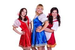 Trois allemands/femmes bavarois Images stock
