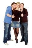Trois amis affichent qui est frais Images libres de droits