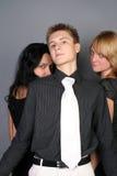 Trois amis ayant l'amusement ensemble Image stock