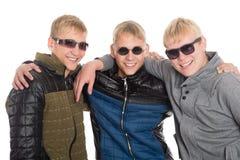 Trois amis dans des lunettes de soleil Image libre de droits