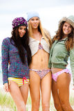 Trois amis dans les bikinis et le survêtement Photo libre de droits