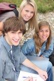 Trois amis de lycée Photos stock