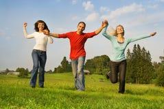 Trois amis heureux Image stock