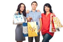 Trois amis heureux aux achats Image libre de droits