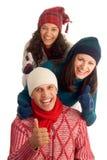 Trois amis heureux de l'hiver Photographie stock libre de droits